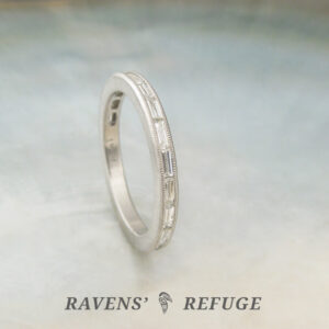 diamond baguette eternity band with milgrain in platinum