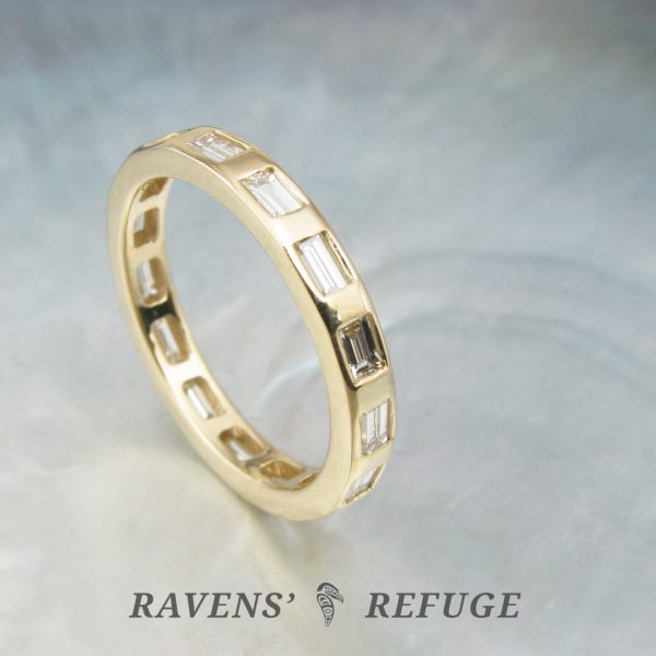 flush set baguette eternity ring – gold stacking band