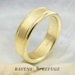 elegant men's wedding band with milgrain, hand forged