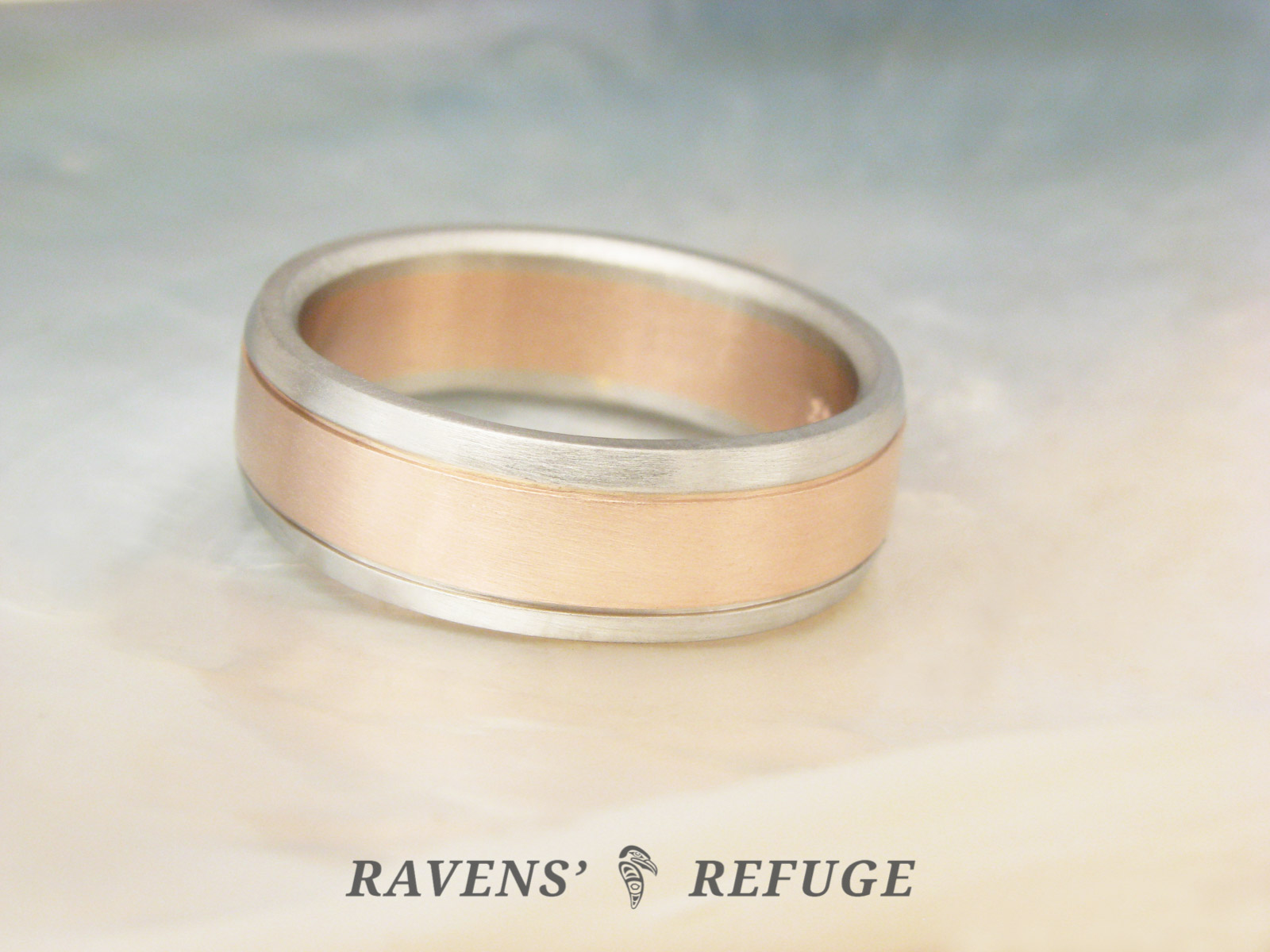 It is an image of rose gold & white gold wedding band – men's two tone ring
