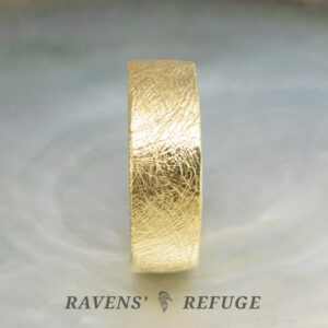 7mm 18k thick gold wedding band with textured finish