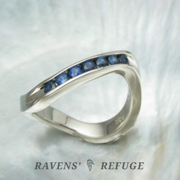 wavy white gold stacking ring with channel set sapphires
