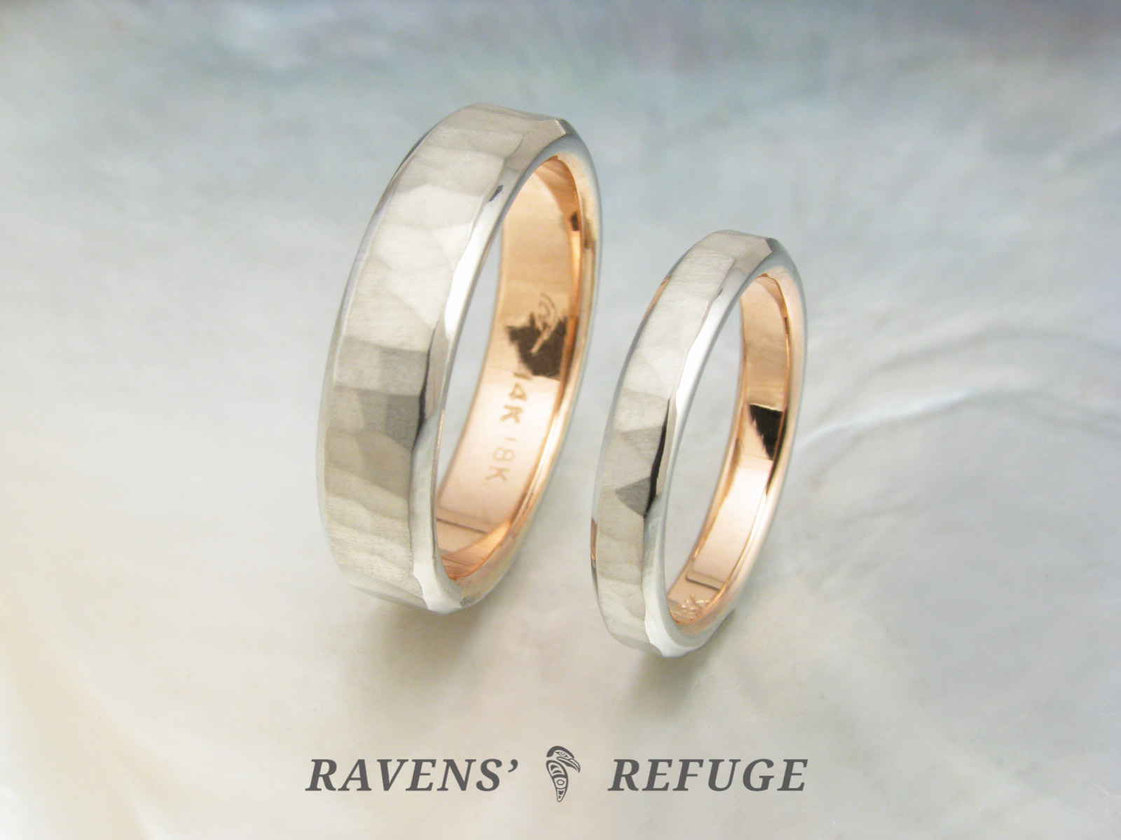 It is a photo of unique white gold wedding band set