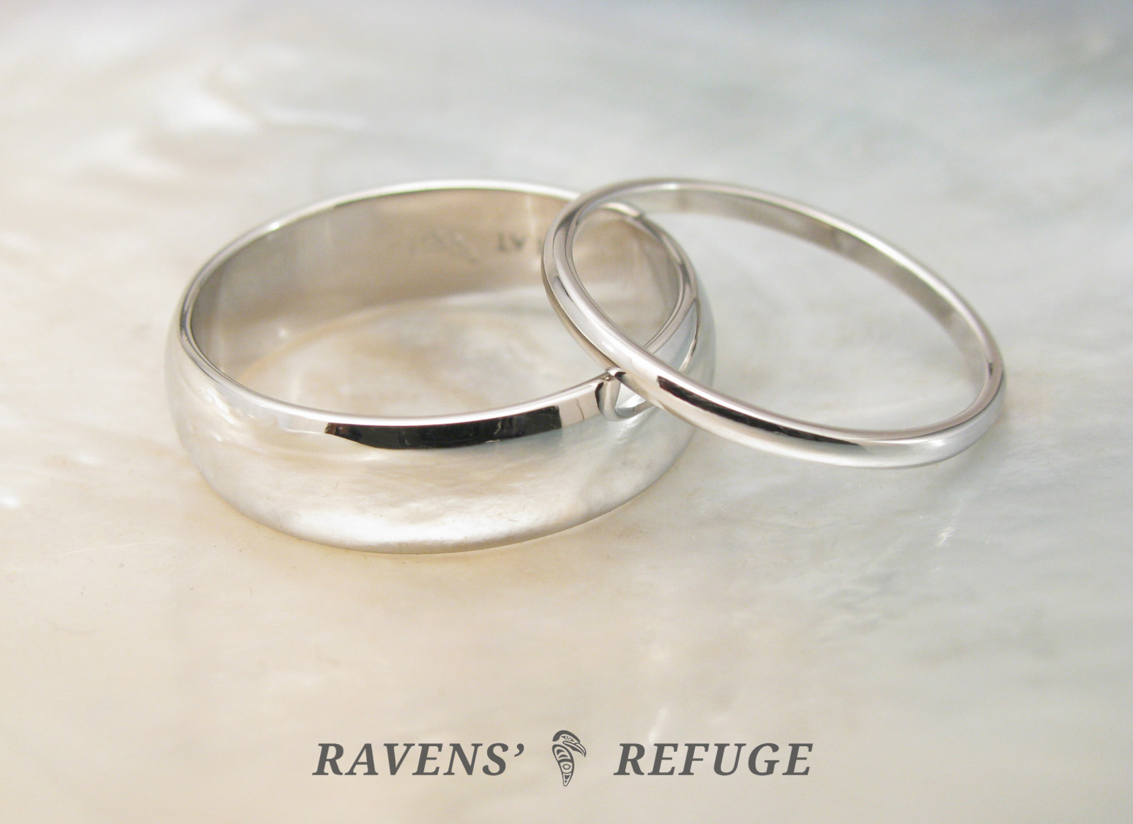 This is a graphic of classic platinum wedding band set, hand forged