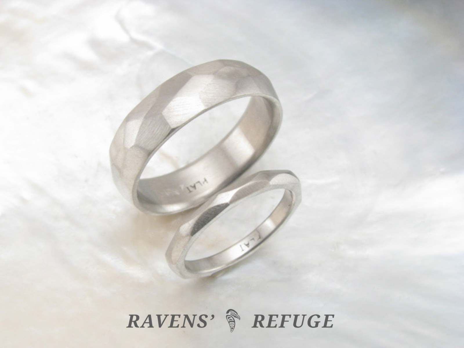 It is a graphic of hand forged platinum wedding band set, his and hers artisan wedding rings