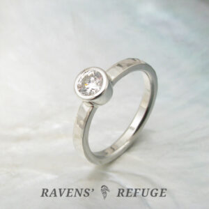 hand forged diamond bezel engagement ring with waterfall hammering