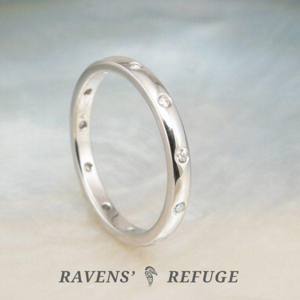 platinum eternity ring with flush set diamonds — handmade anniversary band
