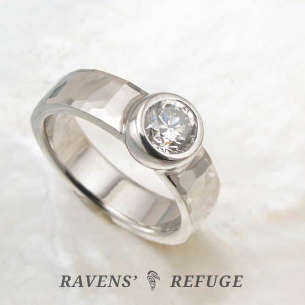 artisan engagement ring with bezel set diamond