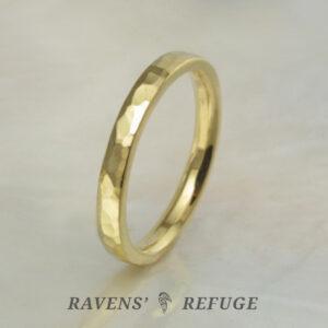 high karat hammered gold wedding band