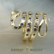 gold snake ring with sapphires or rubies and hammered rustic finish