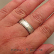 7mm platinum men's wedding band on hand