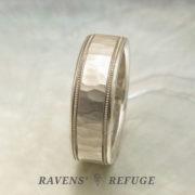 7mm platinum men's wedding band, hammered with milgrain